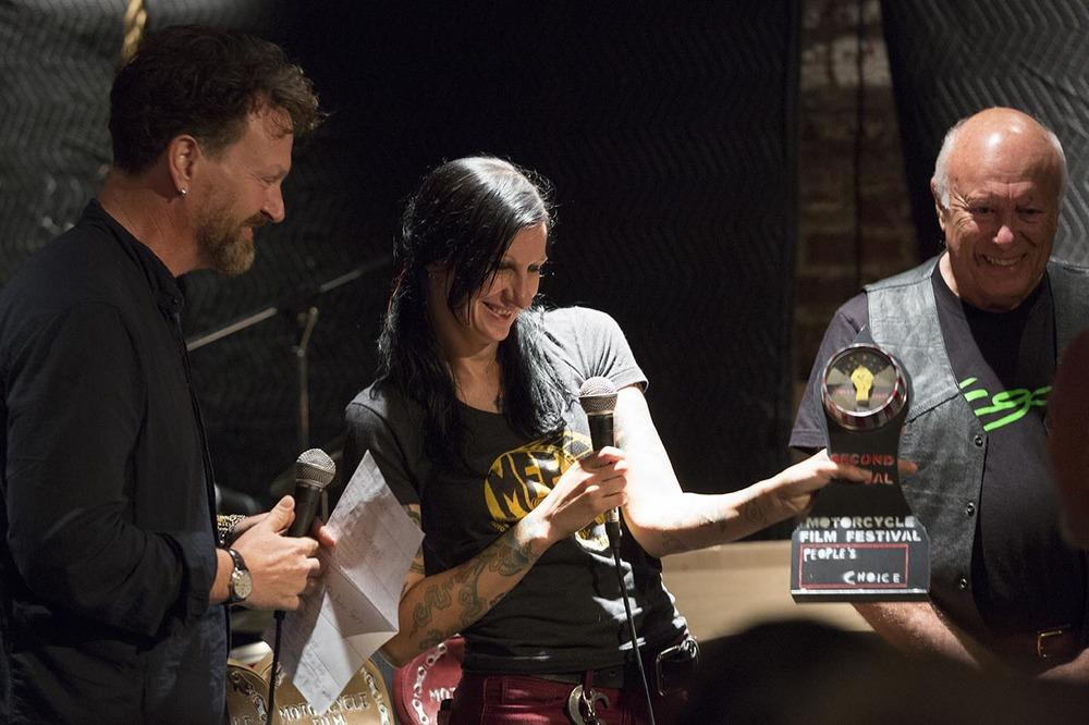 Paul d'Orleans, Corrina Mantlo, and Peter Starr presenting the 2014 Second Annual Motorcycle Film Festival People's Choice award. Photo ©Drury Photos